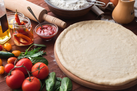 makes: Step-by-step boss makes a pizza margarita. Dough and pizza ingredients