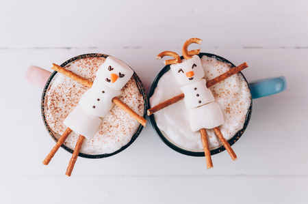 hot couple: mugs with hot chocolate in which the men from the marshmallow relax. concept of a couple