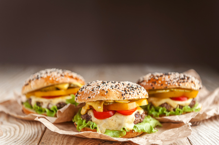 delicious juicy home burger. roll, bagel, with a juicy cutlet from beef, sauces cheese fresh lettuce leaves