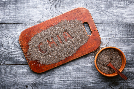 chia seeds on a wooden background. concept of healthy and healthy food.