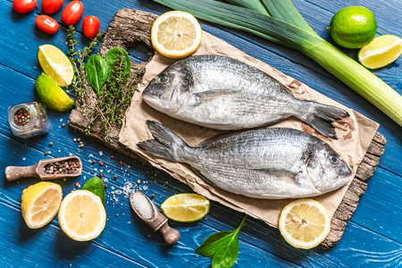 fresh raw dorado fish with spices. dinner for two with your loved one with your own hands. Stock Photo