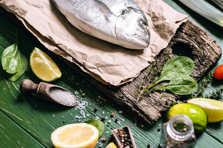 fish for dinner. Fresh raw dorado fish ready for cooking. top view, flat lay Stock Photo