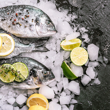 fresh raw dorado fish on ice Stock Photo
