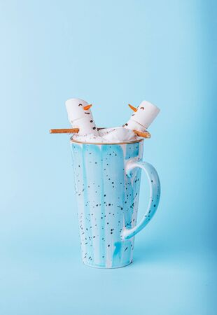 Christmas and winter vacation concept for two in spa and relaxation. two marshmallows in a mug of hot chocolate Stock Photo