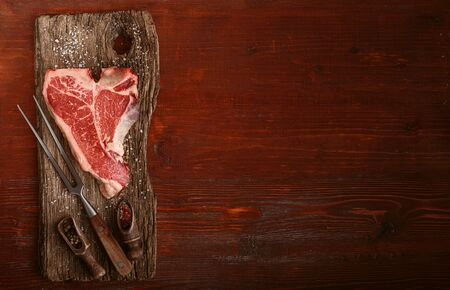 raw tbone steak for blessing day and christmas holidays. A piece of fresh organic farm meat
