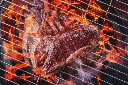 delicious fresh steak on the grill cooked on fire