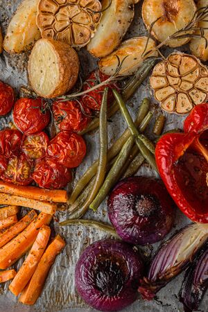 oven-baked vegetables with spices olive oil and fragrant grassmin