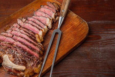 grilled marbled beef steak on a bone