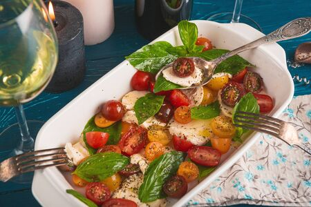 dinner for two with wine and caprese salad