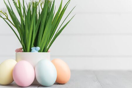 decorative easter eggs on a light wooden background. Easter-themed background with place for text