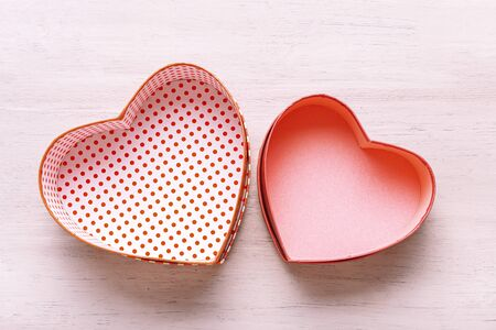 valentines day concept. heart shaped gift boxes on a light wooden table