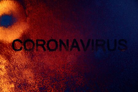 inscription coronavirus made of viruses of spores and bacteria against the background of an abstract image of a microorganism