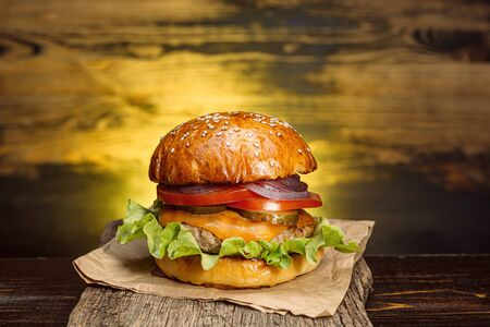 Delicious fresh homemade burger on a wooden table Stock fotó