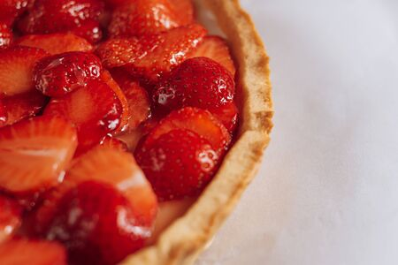 ingredients for strawberry pie, sliced strawberries laid on top of the pie and smeared with lime jelly on top