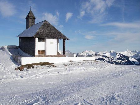 Church in snow mountains (Alps), height 2000 metres photo