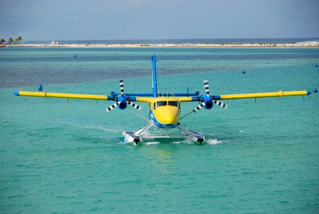 The seaplane has made landing and arrives to a place of a parking, Maldives Stock Photo