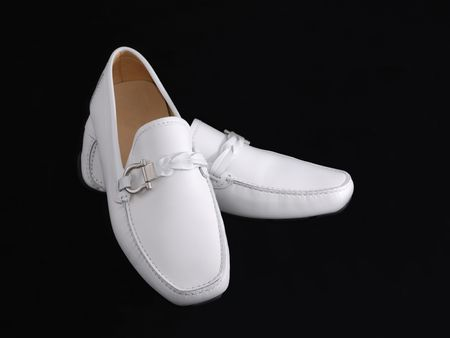 moccasins: A new white mens moccasins on black