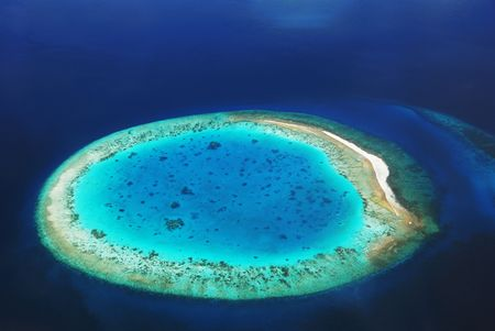 Desert Island with lagoon. This photo was made from the hydroplane in Indian ocean, Maldives.