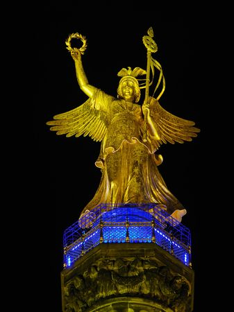 Statue of Angel On Victory Column Siegessaeule in the night, Berlin (Germany) photo
