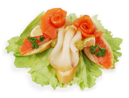 Delicious Smoked Salmon and Sturgeon Appetizer. Isolated on white.
