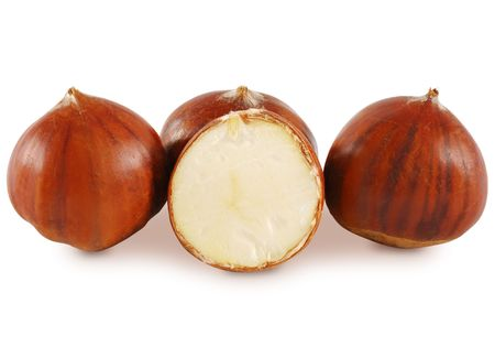 Three whole chestnut and one cuts in half. Isolated on white.