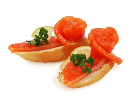 Two Delicious Smoked Salmon Appetizer. Isolated on white.