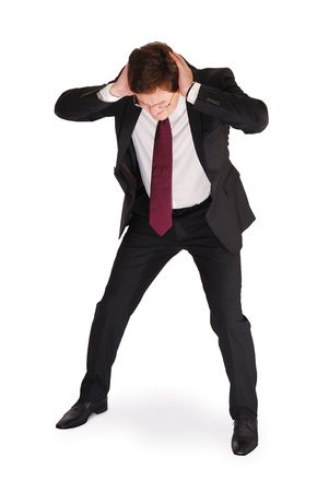 Young man in business suit holding his head with hands with a panic expression. Isolated on white.