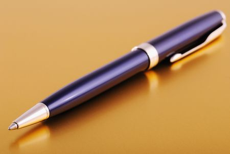 Blue pen on table. Macro shot with shallow depth of focus (on ballpoint).