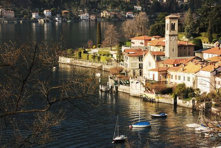 como: Small italian town on the bank of famous lake Como (Lombardy, Italy) in spring time. Stock Photo