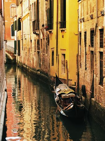 venecian: Typical venecian canal with gondola. Italy, Europe.