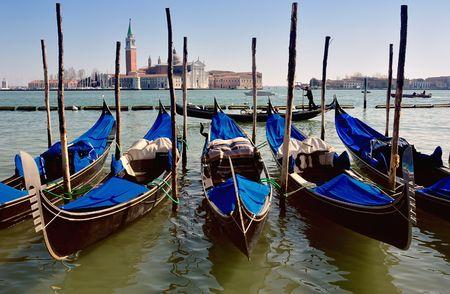 Venetian gondolas frame the San Giorgio Maggiore opposite St. Marks square in Venice, Italy. Stock Photo