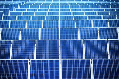 Renewable energy - arranged solar panels. Focus on front. Stock Photo