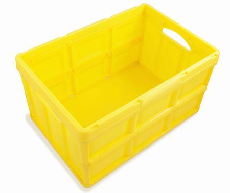 Yellow plastic box isolated on white background. Stock Photo