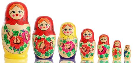 russian culture: Seven traditional wooden Russian dolls. Isolated on white background.