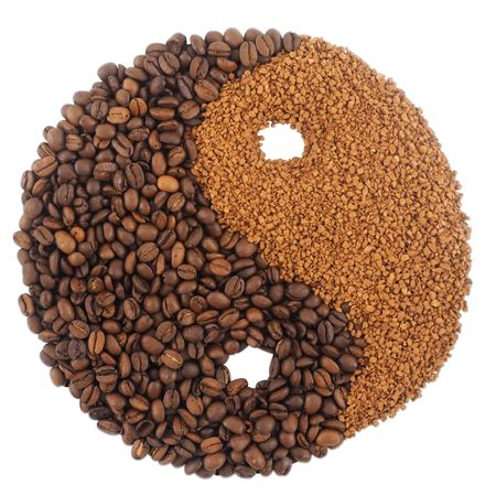 Coffee beans and granules in yin yang shape. Isolated on white background. photo