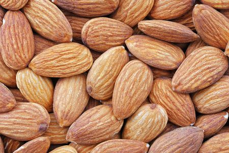 Close up image of shelled almond nuts. Ideal for background. photo
