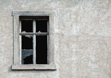 Broken glass window in old wall of abandoned house Stock Photo - 5789477