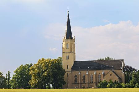 Church is located in Saxony, Germany with clouds in the background