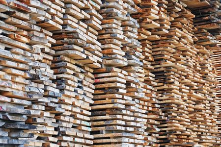 lumber mill: Pile lumber near a lumber mill, waiting for shipping. Stock Photo