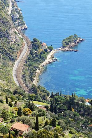 Wonderful view of French Riviera with windy road, turquoise sea and villa from the top of mountain. France, Europe. photo