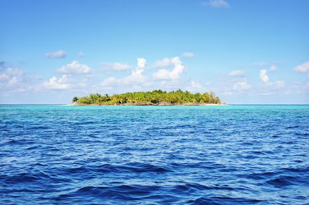 Small uninhabited tropical island in the ocean, Maldives. photo