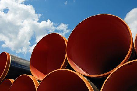 Steel pipes against blue sky
