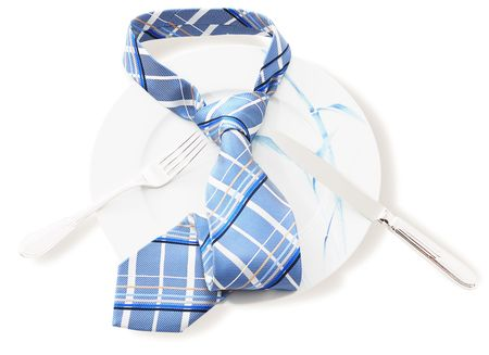 Concept - the business lunch. Plate with a tie isolated on a white background.