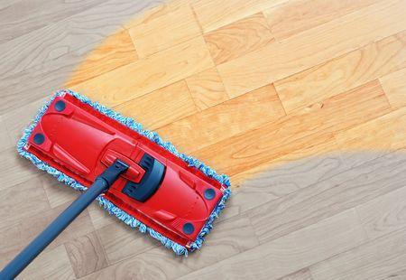 Housework - sweeper wet mop on laminate floors. Stock Photo - 8265597