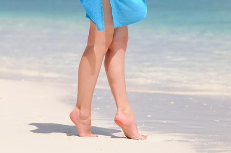 Pair of nice legs walking on a beautiful beach in Maldives Stock Photo