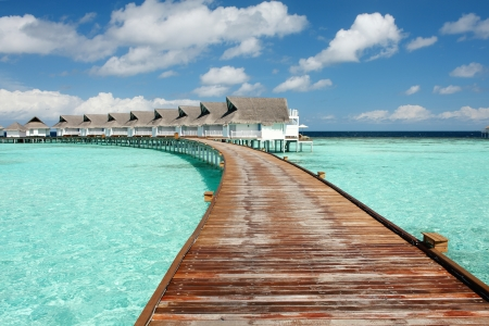 bridge over water: View of jetty leading to water villas on the maldives
