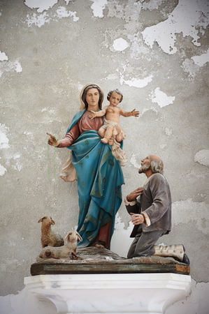 Sculpture of Saint Mary in old church, Italy, Europe Stock Photo
