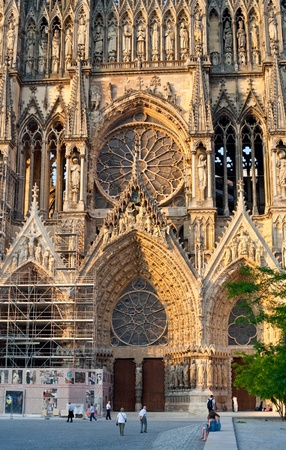 Entrance in gothic catholic Notre Dame Cathedral in Reims, France photo