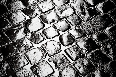 wet old cobblestone road in old town photo