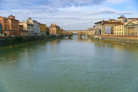 view on Ponte Vecchio in Florence in sunny evening photo